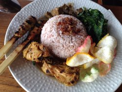red rice with sate lilit and grilled chicken and daun ubi