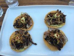 Amazing food, blue fin tuna tostadas, local white wine, blue fin tuna sashimi and yellow tail wi