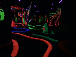 ‪Black Magic Indoor Blacklight Mini Golf‬