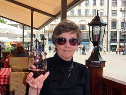 ENJOYING WINE AT THE RESTAURANT IN VOROSMARTY SQUARE