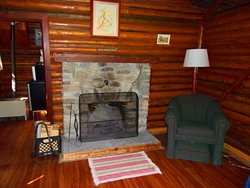 Fireplace and sitting space in cabin 1