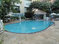 One of the 2 pools on property.