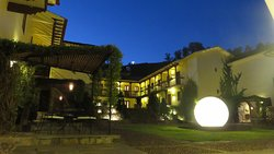 """Cuzco's famous """"Cristo Blanco"""" overlooks the courtyard of beautiful Casa Cartagena Boutique and"""
