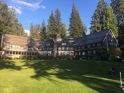 View from the lawn at sunset looking at the back of the lodge. Roosevelt dining room is on the f