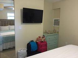 1st bedroom - TV, dresser, A/C, closet