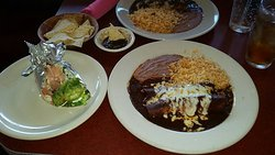 Chicken enchiladas with mole sauce and a fish taco. Awesome!!! Best mole sauce in San Antonio...