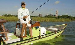 Charlie is fishing near the beautiful lighthouse in Port Aranas, Texas