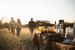 Enjoy sundowners in the bush after a Walking Safari