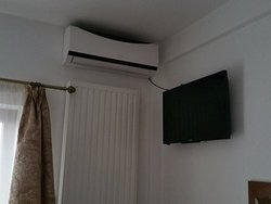 small tv in the room with twin beds