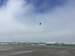 Para-glider out over the ocean