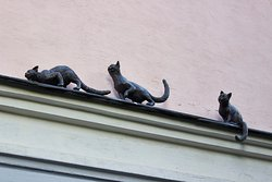Sculpture Cats Chasing Pigeons