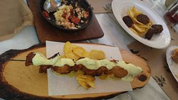 Skewered pork topped with mustard sauce