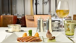 The Grill restaurant & lounge menu highlights the best of French and international cuisine.