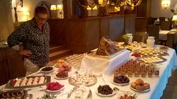 This is the Friday dessert table, my wife looking at all the fine things