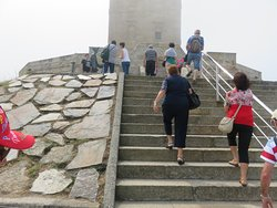 Tourist walking up the steps towards the Tower. Ladies are covering themselves from the cold