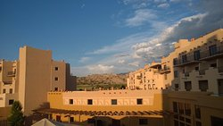 The Santa Fe sky at dusk is the incredible backdrop to adobe style architecture.