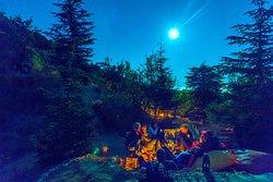Gathering around the fire. Full moon night