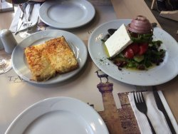 Greek salad and garlic-salami-cheese bread