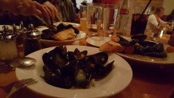 mussels cooked in white wine, garlic, cherry tomatoes and herbs