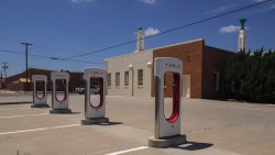 Tesla charging stations behind the building