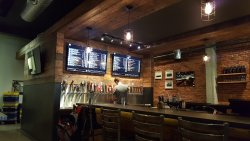 Cool textures, nice use of reclaimed wood. Plenty of choices at the taps!