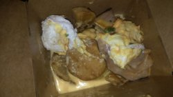 Bad Benedict - dish cold with hard eggs and bad hollandaise. This is the redo in a to go box. Aw