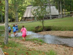 Children wading in streams