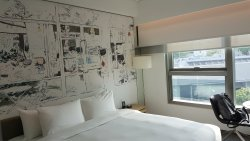 Clean, modern and spacious room with nice mural art