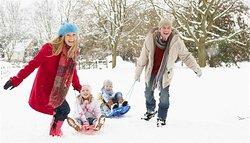 Snow Sledding Family