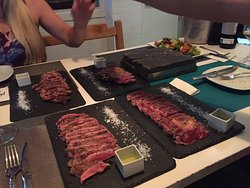 Hot plate on the table to cook your meat to your own preference