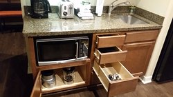 Kitchen - toaster, coffee maker, microwave, blender, but no stove.