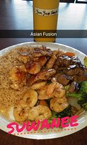 Hibachi with chicken, shrimp and steak- fried rice and vegetables