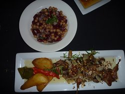 Quail with kidney bean and chickpea salad