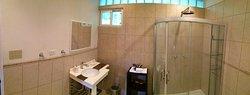Bathroom in our Deluxe Single Bedroom Bungalow (227495319)
