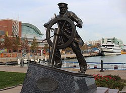 Captain on the helm statue