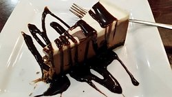 Chocolate Cheesecake features a chocolate crust, dark chocolate, white chocolate and chocolate s