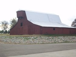 Old red barn that sits on lot adjacent to The Stars and Stripes Museum. I