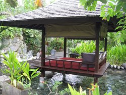 Daybed over water in resort grounds