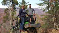 One of the many photo ops on the ride. My wife and I on our UTV.