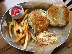 Swordfish sandwich platter with fries and coleslaw
