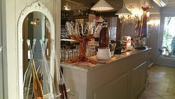 Photo of Bar-- You can see the tall flutes of grappa in the left front