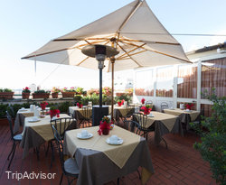 Breakfast Room and Terrace at the Hotel Doria