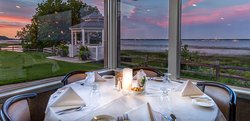Just steps from Lake Michigan, the dining room is perched on a bluff overlooking Little Bay de N