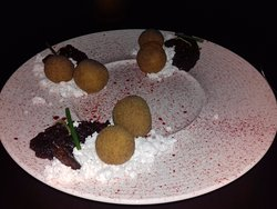 Amazing combination of Goat cheese deep fried balls with beetroot tartar and walnuts.