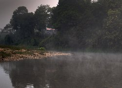 A view of our cottage from the river...an early morning venture into the warm river.