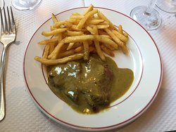 The famous steak frites with the delicious creamy, herby, rich secret sauce...True to the origin