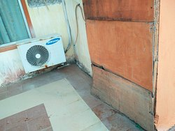Rotting plywood which hides sewage pipes ...also missing in places