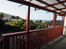 The view from apartment one deck to West End Beach