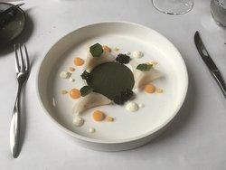 Crab ravioli with seaweed powder