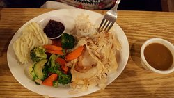 Hot turkey entree with mashed potatoes and fresh vegetables